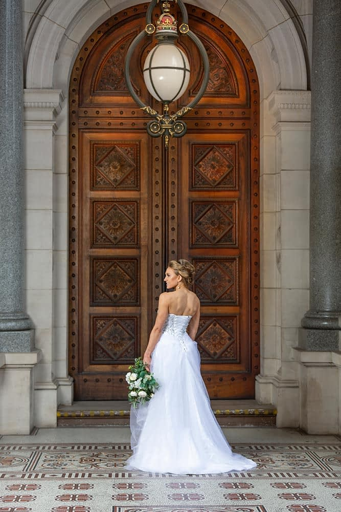 bride portrait in front of beautiful door at Parliament house