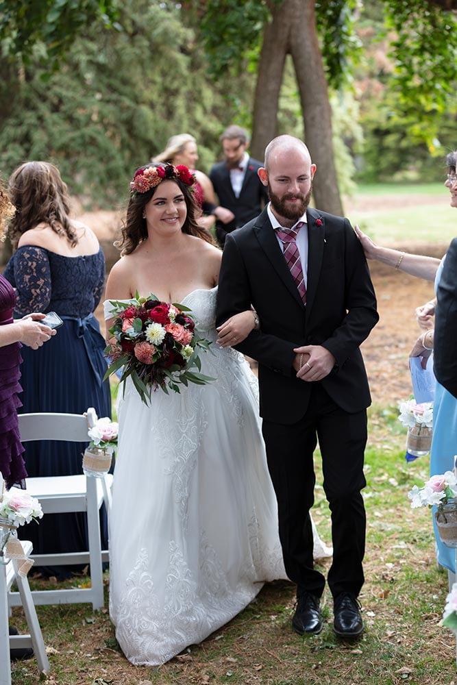 bride and groom walk at wedding ceremony