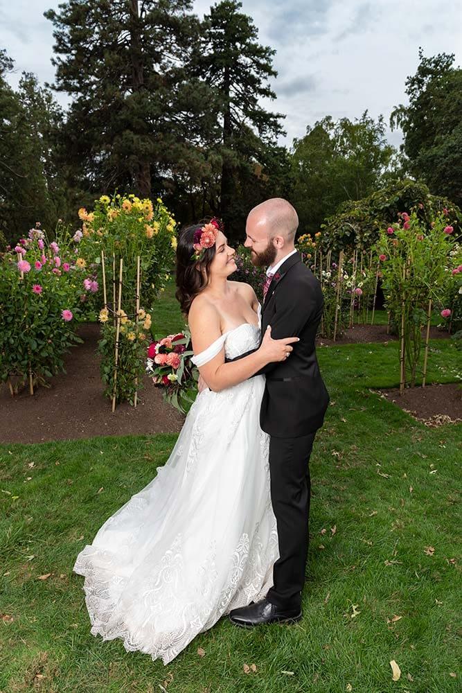 bride and groom hugging at Ballarat botanical gardens