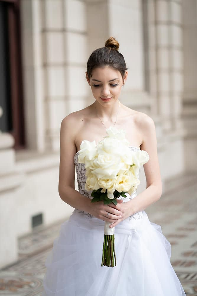 bride holding flower at Parliament house