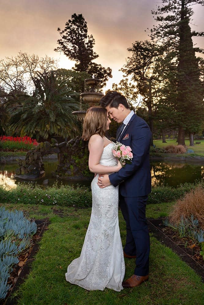 photo of wedding couple at Fitzroy gardens with beautiful sunset