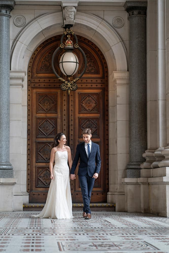Bride and groom walking at Parliament House