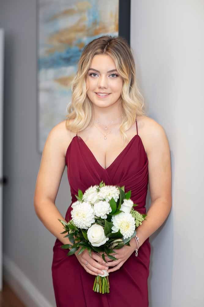 beautiful bridesmaid holding flowers